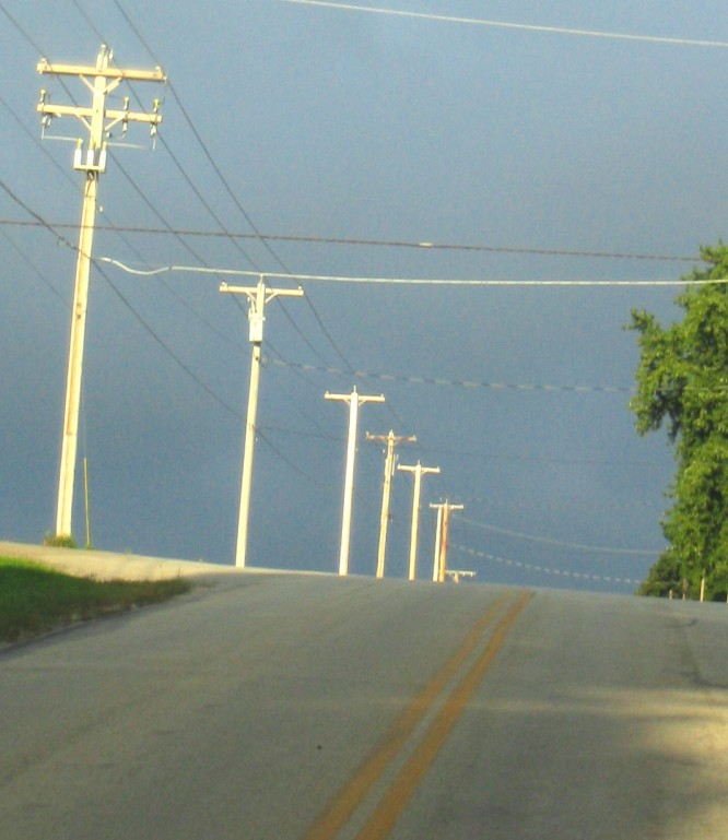 hill-and-telephone-poles