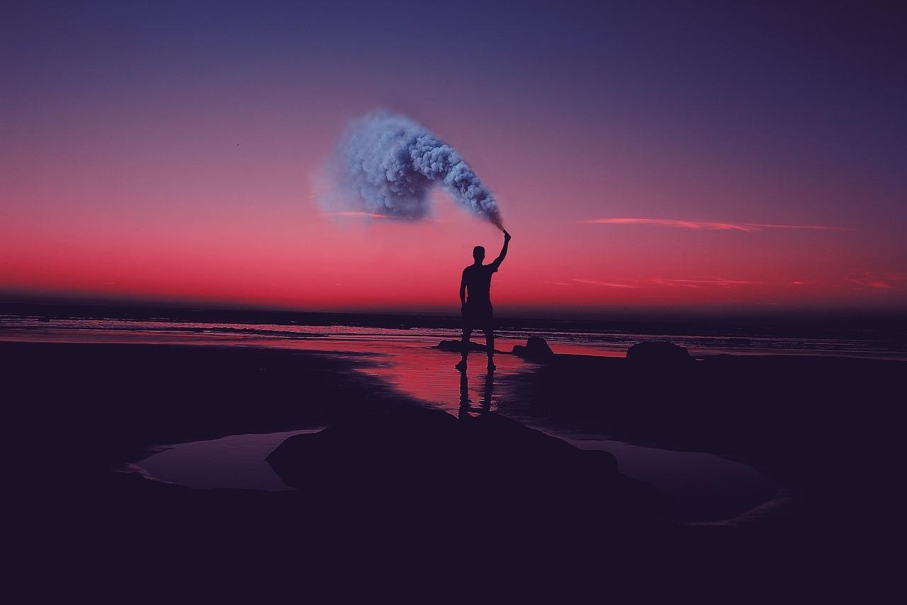 Man w Smoke Flare Beach