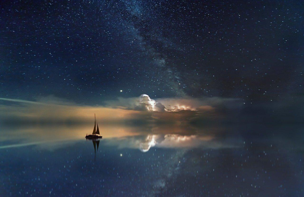 Boat on sea of stars