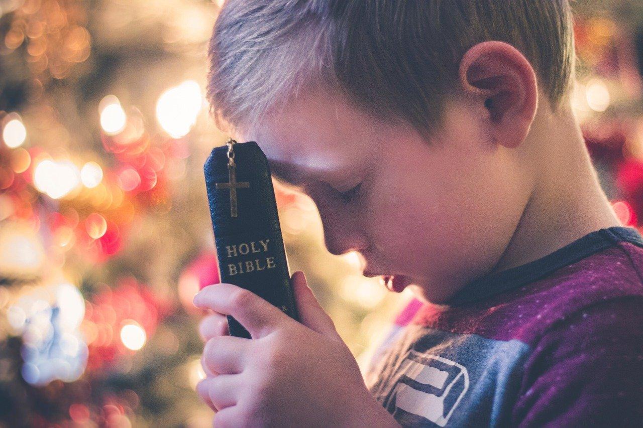 Boy Head Bowed Bible